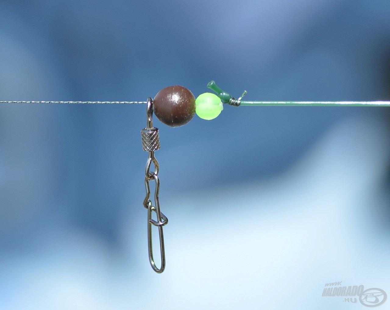 A műanyag gyöngy és gumigolyó megvédi a kötést